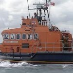 Belfast Coastguard rescue vessel saves from capsized boat wearing his new life jacket