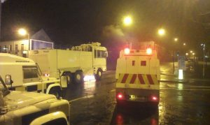 Police and water cannon in Carrickfergus during rioting in December