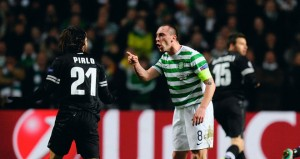 Celtic's Scott Brown in a verbal tussle with Juve's Pirlo