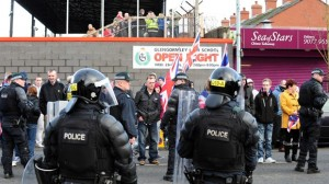Police charge three protestors at Seaview ground on Saturday