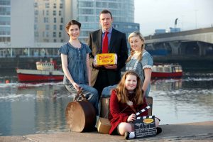 Colin Todd of Brennans Bread with actors Susan Davey and Ruby Campbell and schoolgirl Jessica Potter.
