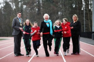 Dame Mary Peters (centre), Belfast Lord Mayor Gavin Robinson (left) and Cllr Deirdere Hargey (right) at revamp Mary Peters track