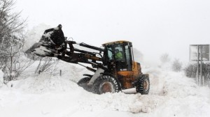 Councils used diggers to clear snow during severe weather conditions