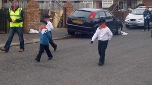 Young children dressed in paramilitary style clothing for dissident republican parade
