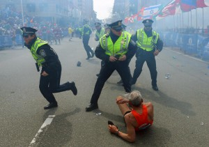 Police at the scene of the bomb blast at finishing line of Boston marathon
