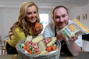 Local chef Niall McKenna and model Tiffany Brien help launch the Brennans Wheaten Brown Bread in Northern Ireland.