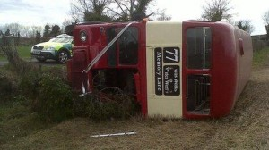 The overturned private double decker bus at scene of Saturday's accident