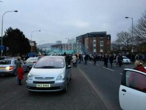 Crowds and cars on the Falls Road in west Belfast on Tuesday night