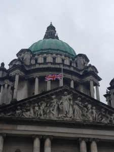 The Union flag flies at half mast over Belfast City Hall to mark the funeral of Baroness Thatcher