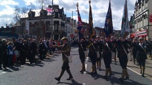 People line the streets of the Ravenhill Road in east Belfast for UVF parade