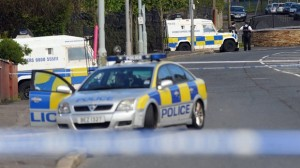Police probing north Belfast murder bid on PSNI officers arrest a 25-year-old man in England