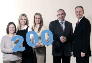 Powerteam has employed its 200th staff member. Pictured is (from left) Powerteam's human resources team Caroline Mageean, Elizabeth Millar and HR Manager, Clare Doran with 200th employee, Barry Heggan and Alastair Dawson, Managing Director, Powerteam