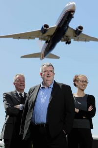 FLYING HIGH:  Northern Ireland's leading independent specialist tour operator Travel Solutions has expanded its local operations with the launch of a new dedicated air holiday division.  Travel Solutions managing director Peter McMinn (centre) and colleagues Rosemary McLaughlin and Robert Wilson are pictured at Belfast International Airport.