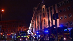 Fire crews tackle blaze at derelict bank premises in Belfast