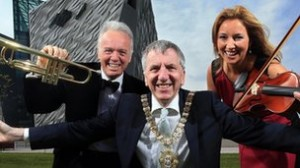 Noel Thompson, Belfast Lord Mayor Mairtin O'Muilleoir and Claire McCollum launch BBC Proms in the Park at Titanic Slipway