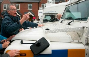 A stand off between Gerry Kelly and one of the PSNI's riot squad landrovers