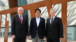 Martin McGuinness and Peter Robinson with Japan's Prime Minister Shinzo Abe at Titanic Belfast