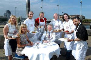 Lord Mayor of Belfast, Councillor Máirtín Ó Muilleoir is joined by Lindsey Hall from Visit Belfast and local chefs and restaurateurs (l-r) Natalie Lennon from Folklore, Tommy Mangan from Shu, John McClean from Birdcage, Tony O'Neill from Thornyhill Restaurants, Michael Dean from Deanes and Askir Ali from Safa, to announce Belfast Restaurant Week. .