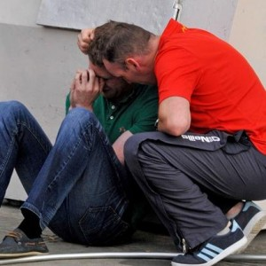 Two men comfort each other at the scene in the Bronx after Newry man Kevin Bell was knocked down