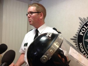 ACC Will Kerr put on display a PSNI riot helmet which he said was dented with a ceremonial sword during violence in north Belfast