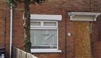 The house in Alliance Avenue where a bomb was left behind the front door to kill PSNI officers