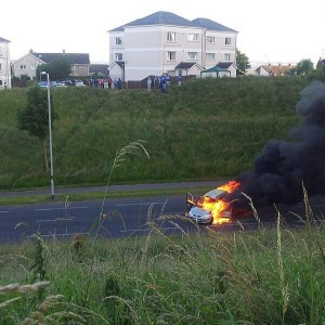 A car on fire on the O'Neill's Road in Glengormley