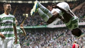 Jumping for joy... Efe Ambrose celebrates with a somersault after scoring Celtic's first goal