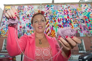 Aine Clarke of Hansel and Gretel with the massive City of Culture quilt