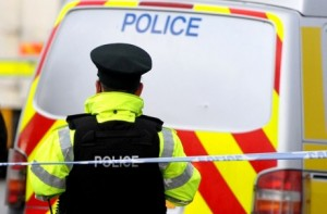 Police cordon off the scene of a double fatal shooting in Glenarm, Co Antrim on Friday evening
