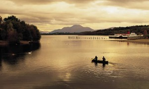 Two people canoeing in Scotland