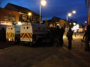 Police in riot gear on the Newtownards Road in east Belfast during sporadic violence