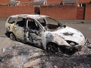 A family estate car burned out on the Albertbridge Road in east Belfast after rioting on Tuesday night