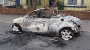 A car burned out during trouble in Belfast on Tuesday evening