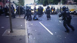 Police officer lies injured during rioting in Belfast on the Twelfth of July