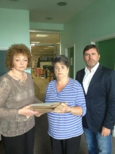 Caral Ni Chuilin hands over the papers to Clara Reilly and Mark Thompson from Relatives for Justice. Picture: Relatives for Justice