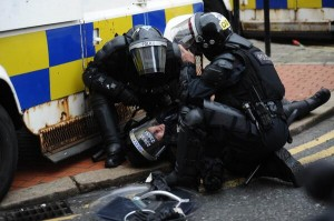 PSNI riot squad officer knocked out after struck by metal missile in Royal Avenue on Friday night