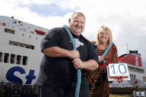 Diane Poole, Stena Line's Head of PR and Communications who is lending a helping hand to event organiser Glenn Ross as they get ready for the Ultimate Strongman weekend