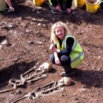 "Dr Emily Murray with two of the skeletal remains found at the Bishop Street ""dig."""