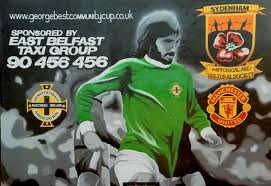 The George Best mural in east Belfast is now being replaced by a masked UVF gunman
