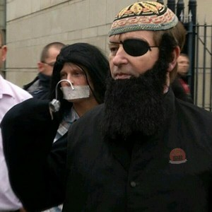 Willie Frazer dressed as 'Hook Hamza' for his court appearance in Belfast alongside Jamie Bryson with tape over his mouth