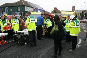 Paramedics and doctors at the scene of west Belfast crash which left 10 people injured