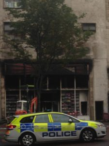 Police guard over the gutted B and M store in Belfast City Centre
