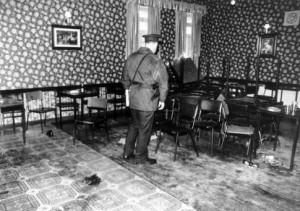 An RUC officer observes the aftermath of the Rising Sun pub massacre in 1993