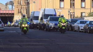 A convoy of police vehicles bring dissident republican suspects to court in Glasgow