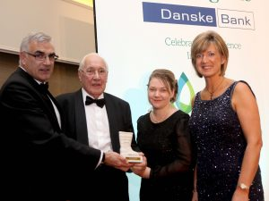 John Gordon MBE received the unsung hero awards.  He is pictured receiving his award from sponsor Philip Rainey, Simple Power, Ruth Rodgers, editor of Farming Life, and Roberta Armstrong, Danske Bank