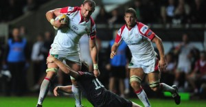 Ulster's Dan Tuohy brushes off an Osprey's tackle at the Liberty Stadium