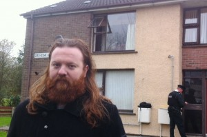 Richard Meenan outside the block of flats where a fire broke out