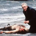Fr Alec Reids gives the last rites to one of the two corporals murdered by the IRA in 1988