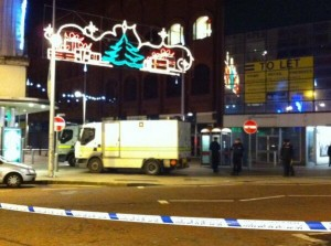 Army bomb squad officers at Cornmarket on Monday night after a firebomb ignites