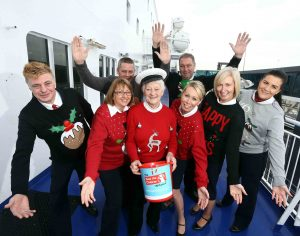 Georgie Johnston, Save The Children, is pictured with Stena Line staff who are encouraging customers to get into the festive spirit on December 20 and 21 by sporting their Christmas jumpers in aid of Save The Children